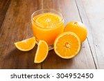 fresh orange juice on wooden... | Shutterstock . vector #304952450