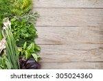 fresh garden herbs on wooden... | Shutterstock . vector #305024360