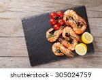 grilled shrimps on stone plate... | Shutterstock . vector #305024759