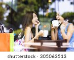 two young woman chatting in a... | Shutterstock . vector #305063513