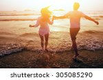 happy couple on the beach ... | Shutterstock . vector #305085290