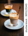 close up two glasses of coffe   ... | Shutterstock . vector #305125343