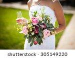 beautiful stylish bride holding ... | Shutterstock . vector #305149220