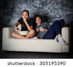 two young girls looks tv at... | Shutterstock . vector #305195390