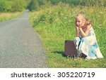 tired little girl with suitcase ... | Shutterstock . vector #305220719