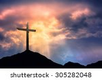 Silhouette Of Cross At Sunrise...