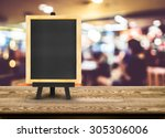 blackboard menu with easel on... | Shutterstock . vector #305306006