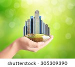 building city center on hand | Shutterstock . vector #305309390