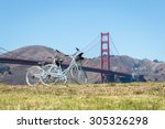 Two Bicycles Parked On Grass I...