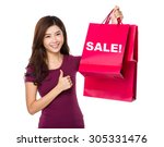 Happy Shopping Young Woman With ...
