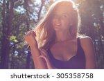beautiful portrait of a happy... | Shutterstock . vector #305358758