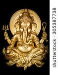 Small photo of Golden hindu god ganesh on a black background.