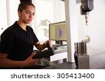 female engineer using cad... | Shutterstock . vector #305413400