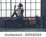 fit woman in profile sitting on ... | Shutterstock . vector #305430164