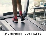 unknown woman wear pink running ...   Shutterstock . vector #305441558
