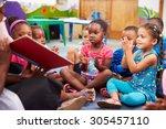 teacher reading a book with a... | Shutterstock . vector #305457110