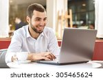 young businessman sitting in a... | Shutterstock . vector #305465624