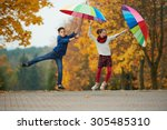 boy and girl among the leaves... | Shutterstock . vector #305485310