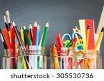 school supplies in jars against ... | Shutterstock . vector #305530736