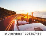 happy couple driving on country ... | Shutterstock . vector #305567459