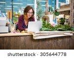 mid adult female florist using... | Shutterstock . vector #305644778
