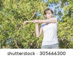 woman do stretching exercise at ... | Shutterstock . vector #305666300