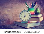 alarm clock  book stack and