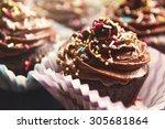 delicious chocolate cupcakes...   Shutterstock . vector #305681864