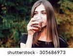 Beautiful Young Girl Drinks...