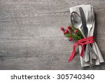 christmas table place setting  | Shutterstock . vector #305740340