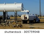 Small photo of BAKERSFIELD, CA - AUGUST 11, 2015 : A water truck is loading on a construction job site after which it will spray the bare ground for dust abatement.