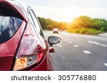 red automobile on the road at... | Shutterstock . vector #305776880