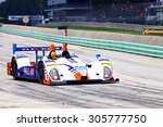 Elkhart Lake, Wisconsin USA - August 9, 2015: Road America road course, IMSA CORE autosport, Flex Box / Composite Resources, ORECA FLM09 makes a quick pit stop. powered by Chevrolet - stock photo