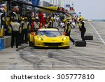 Elkhart Lake, Wisconsin USA - August 9, 2015: Road America road course, IMSA - Corvette racing team cars make tire and fuel pit stop. Corvette C7.R IMSA Tudor GT Le Mans class. - stock photo