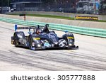 Elkhart Lake, Wisconsin USA - August 9, 2015: Road America road course, IMSA. ORECA FLM09 of PR1/Mathiasen Motorsports Cuttwood powered by Chevrolet - stock photo