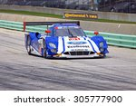Elkhart Lake, Wisconsin USA - August 9, 2015: Road America road course, IMSA. Rinning down pit lane, Chip Ganassi Racing with Felix Sabates car, Ford EcoBoost Riley DP. - stock photo