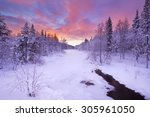 Stock photo a frozen river in a wintry landscape photographed near levi in finnish lapland at sunrise 305961050