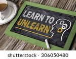 Small photo of learn to unlearn concept on chalkboard