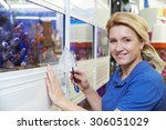 Stock photo portrait of female employee in pet store 306051029