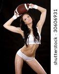 pretty brunette holding ball on ... | Shutterstock . vector #30606931
