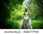 Small photo of runaway bride in the forest