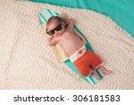 Newborn Baby Boy Sleeping On A...