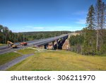 Saint Petersburg, Russia - August 7, 2015: Steel bridge over the forest stream under construction. - stock photo