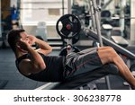 sportsman doing crunches in the ... | Shutterstock . vector #306238778