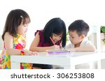 kids drawing with colored pencil | Shutterstock . vector #306253808