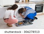 repairman repairing washer in... | Shutterstock . vector #306278513