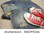 red shoes with jeans on cement... | Shutterstock . vector #306295166