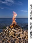 fire burning on the sea in... | Shutterstock . vector #306363968