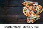 slices of mini pizza variety... | Shutterstock . vector #306377753