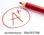 red pencil and a plus grade... | Shutterstock . vector #306393788